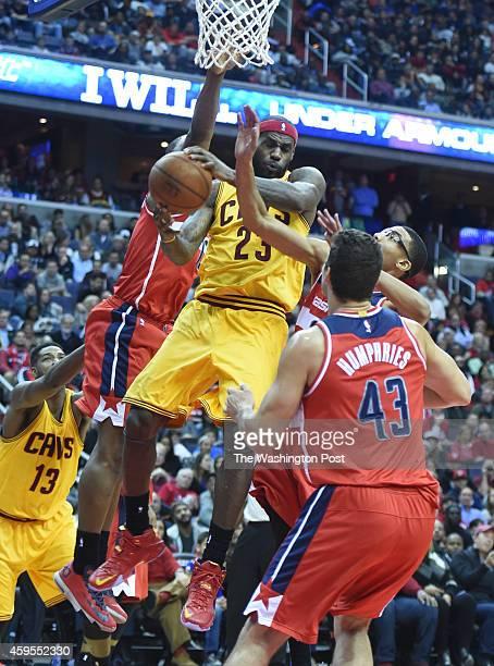 Cleveland Cavaliers forward LeBron James draws three Washington Wizards defenders as he goes to the basket during fourth period action on November 21...