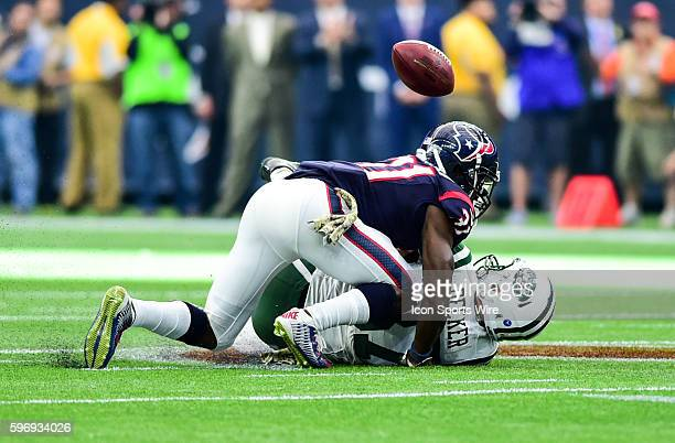 Houston Texans Cornerback Charles James puts a big hit on New York Jets Wide Receiver Eric Decker as the pass falls incomplete during the Jets at...
