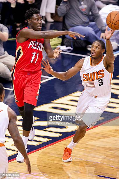 New Orleans Pelicans guard Jrue Holiday shoots against Phoenix Suns guard Brandon Knight during the game between the Phoenix Suns and New Orleans...