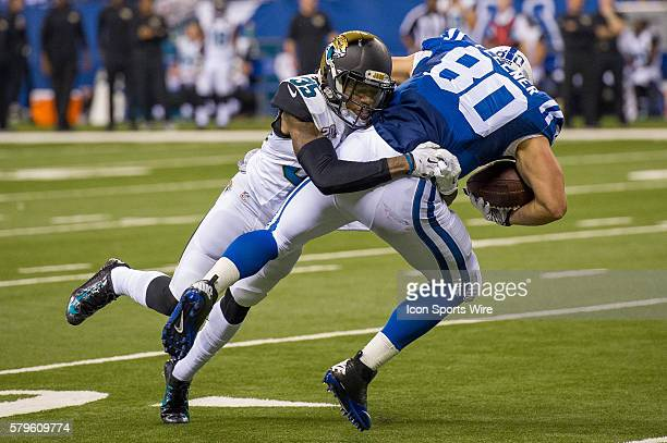 Jacksonville Jaguars cornerback Demetrius McCray tackles Indianapolis Colts tight end Coby Fleener during a football game between the Indianapolis...