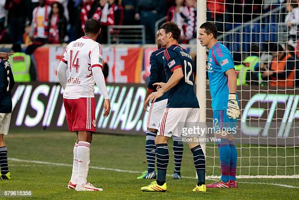 New England Revolution's Andy Dorman keeps close tabs on his defensive assignment New York Red Bulls' Thierry Henry The New England Revolution...