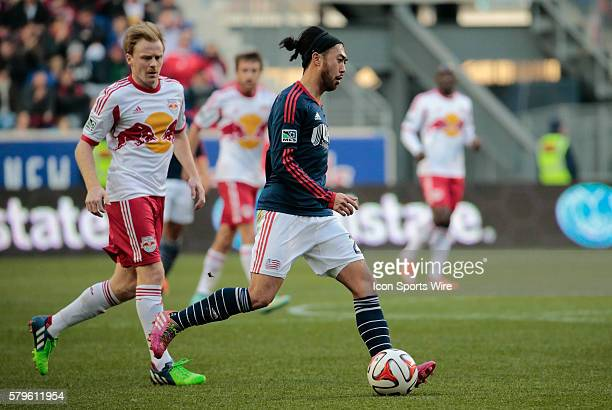 New England Revolution's Lee Nguyen controls the ball in midfield watched by New York Red Bulls' Dax McCarty The New England Revolution defeated the...