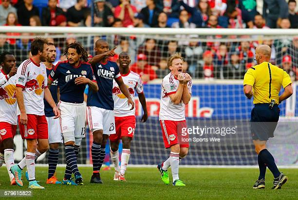 New York Red Bulls' Dax McCarty can not believe the call from Referee Allen Chapman The New England Revolution defeated the New York Red Bulls 21 in...