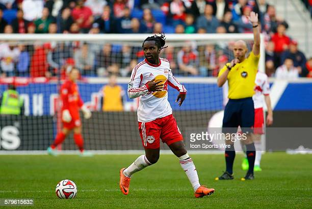 New York Red Bulls' Peguy Luyindula The New England Revolution defeated the New York Red Bulls 21 in the first leg of the Eastern Conference Finals...