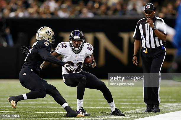 Baltimore Ravens wide receiver Torrey Smith is stopped by New Orleans Saints cornerback Patrick Robinson at the MercedesBenz Superdome in New Orleans...