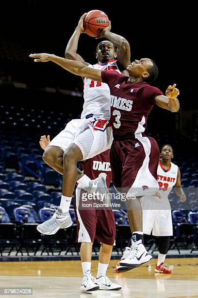 Detroit Titans guard Jarod Williams goes in for a layup against Maryland Eastern Shore guard Mark Blackmon during a Progressive Legends Classic...