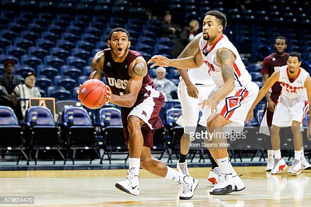 Maryland Eastern Shore forward Iman Johnson looks to shoot over Detroit Titans forward Juwan Howard Jr. During a Progressive Legends Classic...