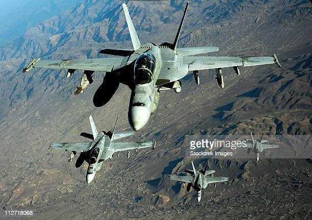November 25, 2010 - Four U.S. Navy F/A-18 Hornet aircraft fly over mountains in Afghanistan.
