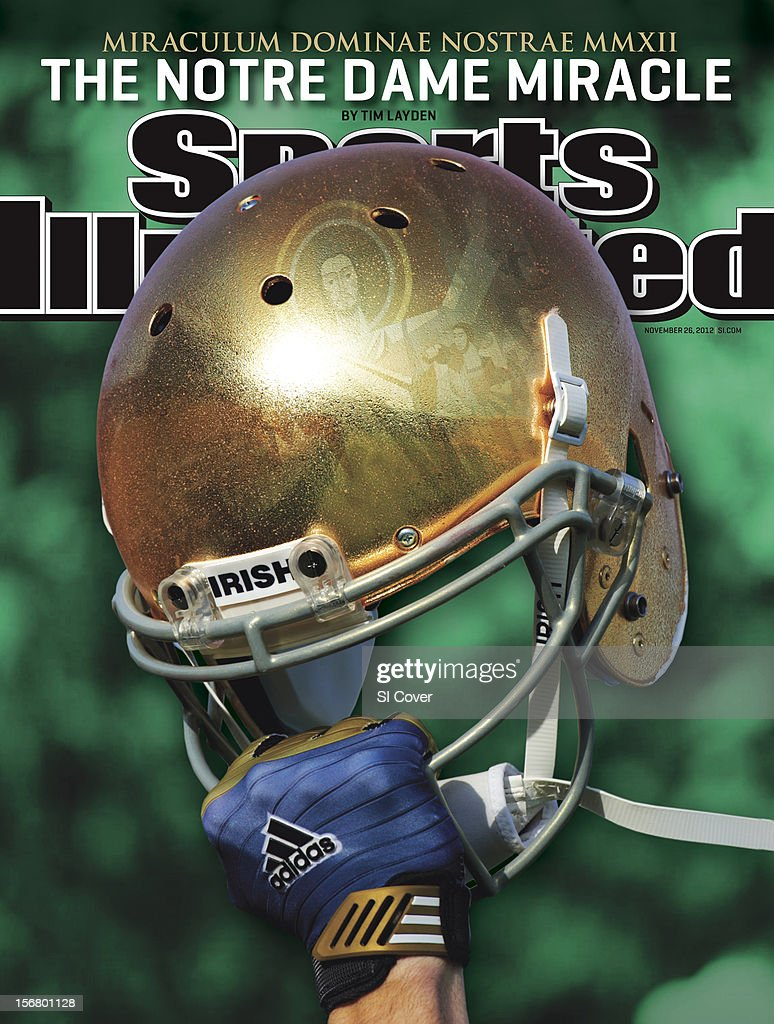 November 26, 2012 Sports Illustrated Cover: Closeup portrait of hand holding Notre Dame helmet during photo shoot at Notre Dame Stadium. Composite photo illustration of Touchdown Jesus reflection by SI Imaging. Background photo by Damian Strohmeyer. David E. Klutho ]
