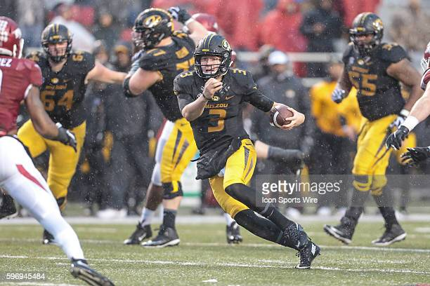 Missouri Tigers quarterback Drew Lock carries for a big gain during an NCAA football game between the Missouri Tigers and the Arkansas Razorbacks at...