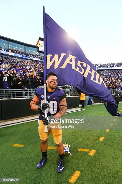 Washington's Taniela Tupou waves a Washington Flag on the field after the game against Washington State Washington defeated Washington State 4510 at...