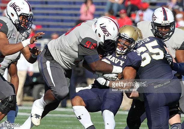 South Alabama Jaguars defensive lineman Jerome McClain tackles Navy Midshipmen running back Ryan WilliamsJenkins during the Navy at South Alabama...