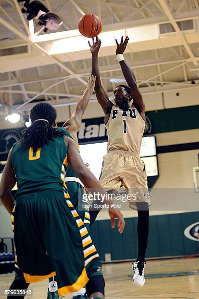 Jason Boswell Guard Florida International University Panthers shoots a basket against the Wright State University Raiders in the Upstate Classic at...