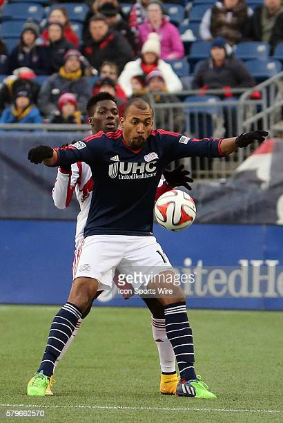 New England Revolution's Teal Bunbury shields the ball from New York Red Bulls' Ambroise Oyongo The New York Red Bulls and the New England Revolution...