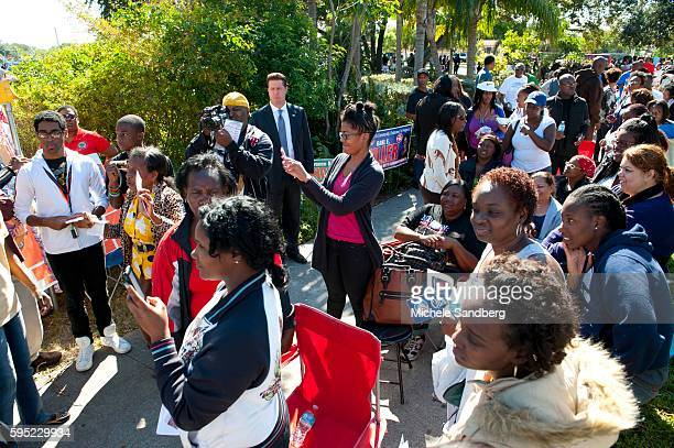 November 3 2012 CROWDS OF EARLY VOTERS WAITINIG OVER FIVE HOURS TO VOTE EMBRACING VALERIE JARRETT Senior Advisor To President Obama VALERIE JARRETT...