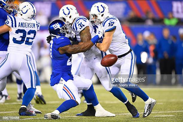 Indianapolis Colts wide receiver Griff Whalen fumbles ball after running into Indianapolis Colts defensive back Dewey McDonald on a punt return as...