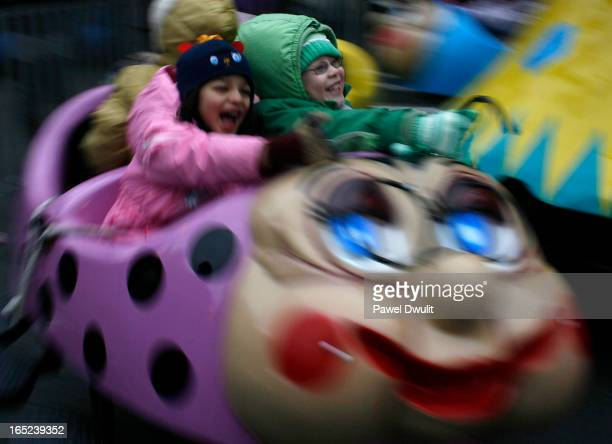 November 30 2008 Jaina Baltazar 5 in green hangs on tight while on a lady bug ride during the Yonge Business Improvement Area's Winter Magic event in...