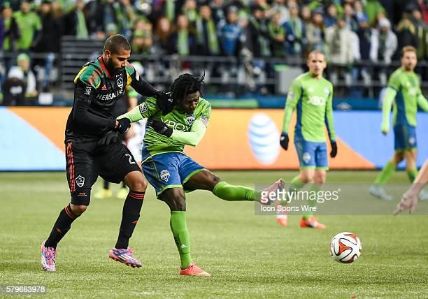 CenturyLink Field Seattle Washington Angeles Galaxy defender Leonardo grabs Obafemi Martins as Seattle Sounders FC wins the match against the LA...