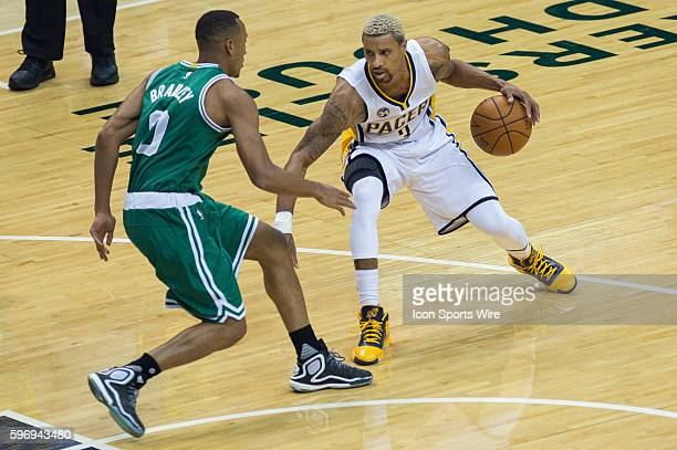 Boston Celtics guard Avery Bradley defends Indiana Pacers guard George Hill during a NBA game between the Indiana Pacers and Boston Celtics at...