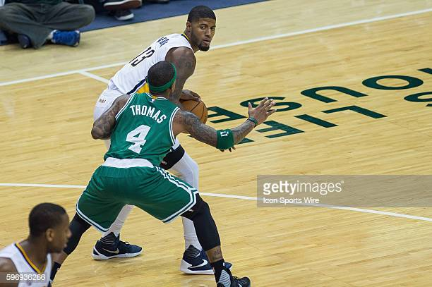 Boston Celtics guard Isaiah Thomas defends Indiana Pacers forward Paul George during a NBA game between the Indiana Pacers and Boston Celtics at...