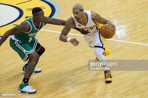 Boston Celtics guard Terry Rozier defends Indiana Pacers guard George Hill during a NBA game between the Indiana Pacers and Boston Celtics at Bankers...