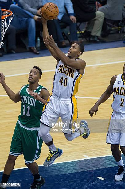 Indiana Pacers guard Glenn Robinson III drives in the lane past Boston Celtics guard Evan Turner during a NBA game between the Indiana Pacers and...