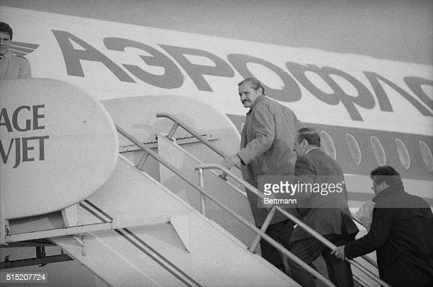 November 6 1985 Washington DC Soviet KGB officer Vitaly Yurchenko looks back as he boards a Aeroflot jet at Dulles Airport for a return flight to...