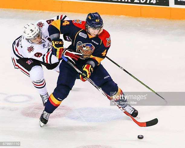 Erie D Travis Dermott stick handles past Niagara's C Jordan Maletta during Niagara's 52 victory at Meridian Center in St Catherine's Ontario