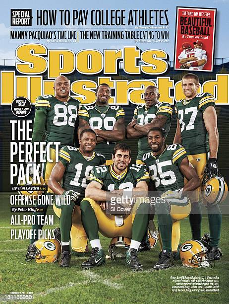 November 7 2011 Sports Illustrated via Getty Images Cover Portrait of Green Bay Packers QB Aaron Rodgers with offense Jermichael Finley Randall Cobb...