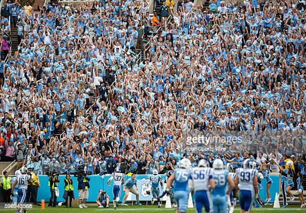 Fans in the North Carolina Tar Heel student section react as wide receiver Bug Howard scores a touchdown during the first half of the Tar Heels' NCAA...