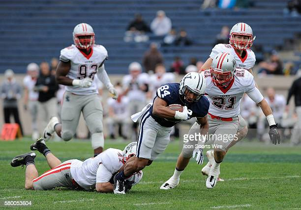 Yale wide receiver Christopher WilliamsLopez carries the ball up the field an is tackled by Brown Bears outside linebacker Ryan MacDonald The Brown...