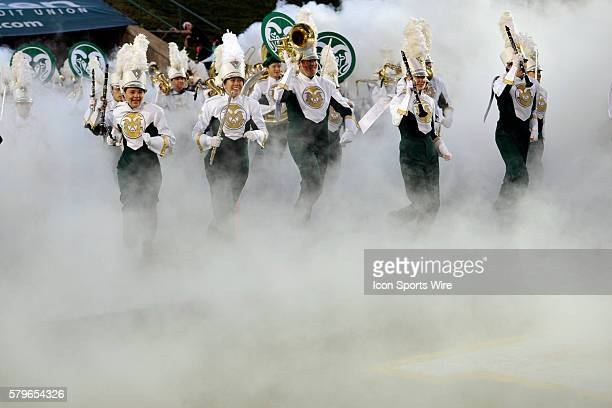The Colorado State Marching Band takes to the field prior to the game between the Hawai'i Rainbow Warriors and the Colorado State Rams at Hughes...