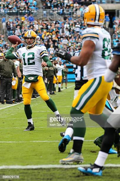Green Bay Packers quarterback Aaron Rodgers passes on the run for a score to Green Bay Packers tight end Richard Rodgers during the first quarter...