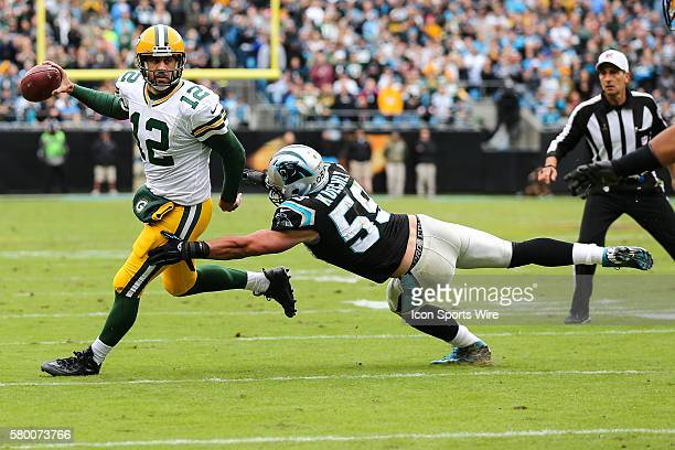 Green Bay Packers quarterback Aaron Rodgers tries to elude Carolina Panthers middle linebacker Luke Kuechly on a pass play during the game between...