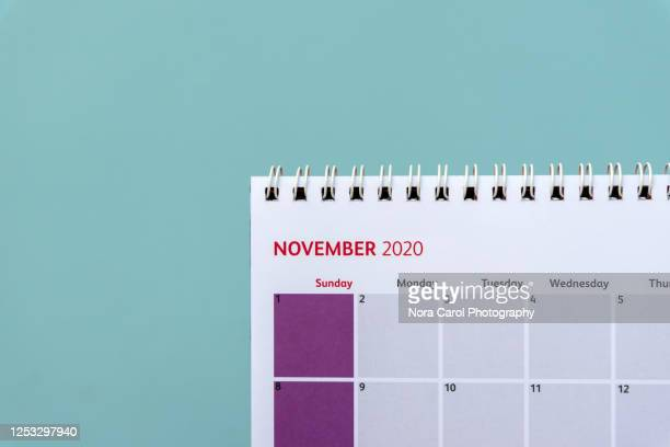 november calendar on blue background - november stock pictures, royalty-free photos & images