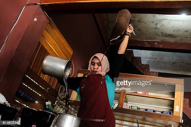 Novi Riantika Barista is woman was dispensing coffee Aceh using local barista techniques in Lhokseumawe Aceh province Indonesia On October 14 2016...