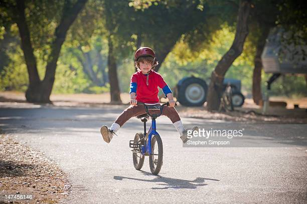 novice bicycle rider trying new tricks