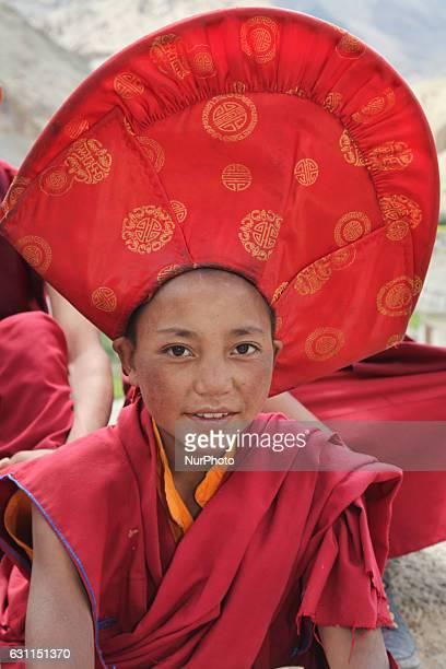 Novice Buddhist monk dressed in ceremonial attire during the Mask Dance Festival at the Lamayuru Monastery in Lamayuru Ladakh Jammu and Kashmir India...