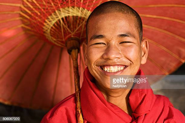 Novice Buddhist monk holding umbrella, Myanmar