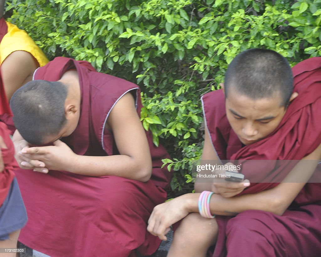 Novice Buddhist monks at Terger Monastery after the blasts in the Mahabodhi Temple campus at Bodhgaya on July 7, 2013 in Bihar, India. Nine serial explosions today rocked the internationally renowned temple town of Bodhgaya. Two people have been injured in a series of blasts inside the Mahabodhi temple in Bihar's Bodhgaya district.