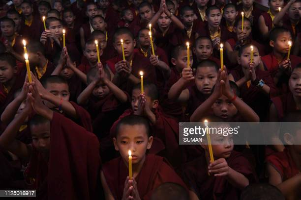 TOPSHOT Novice Buddhist monks offer prayers at Tergar monastery in Bodhgaya in the Indian state of Bihar on February 15 the day after an attack on a...
