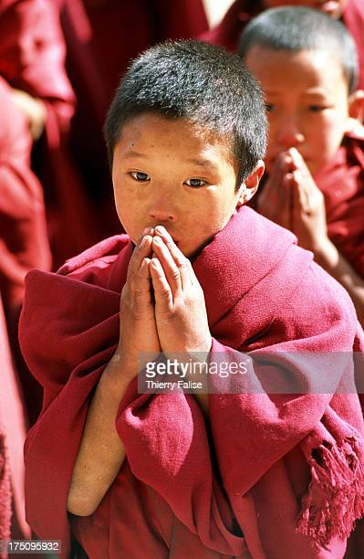 A novice in a prayer before going to class