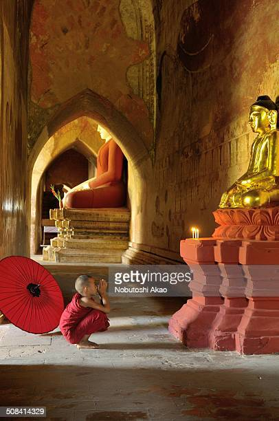CONTENT] A novice monk from the nearby monastry is praying at Sulamani Temple in Bagan Myanmar Bagan the ancient capital of Myanmar is said to be one...
