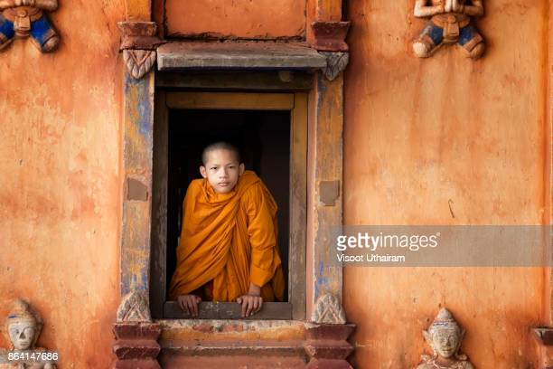 novice monk in temple,luang prabang,laos - religious celebration stock pictures, royalty-free photos & images