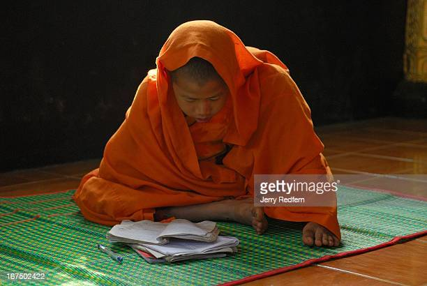 A novice monk practices Buddhist prayers at a monastery in Kengtung