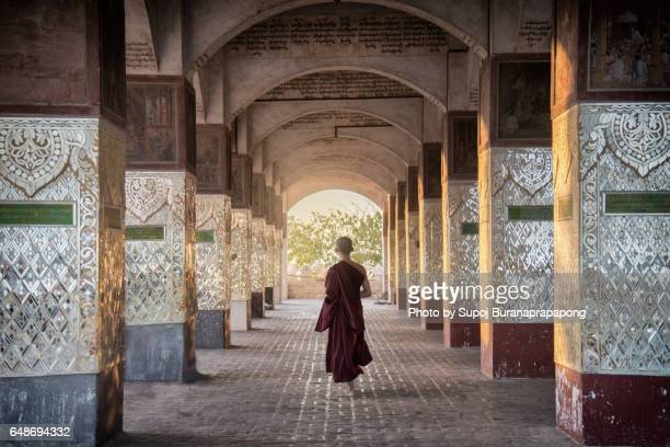 Novice monk walking on Mandalay Hill , Myanmar