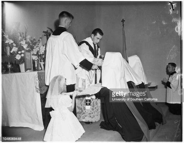 Novice nuns, 18 August 1951. Margaret Mulrooney ;Juanita Quigley ;Evelyn Schwalenberg ;Ann Ryan -- 7 years;Bishop Timothy Manning;Judy...