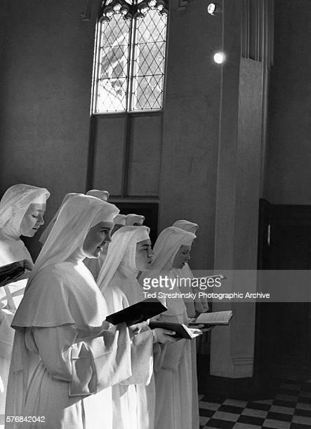 Novice nuns at a Dominican convent celebrate Christmas singing carols in the chapel. San Rafael, California.