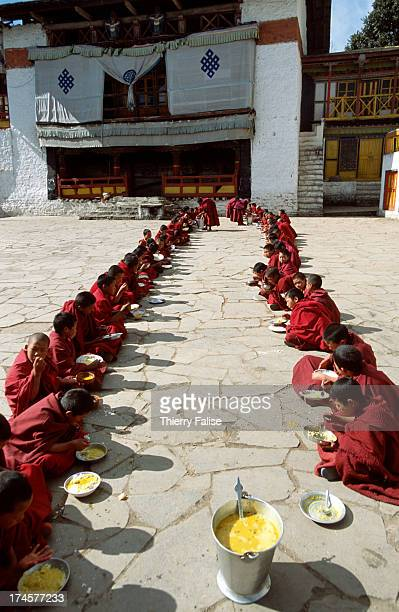 Novices at lunch time in the main courtyard of the Tawang monastery