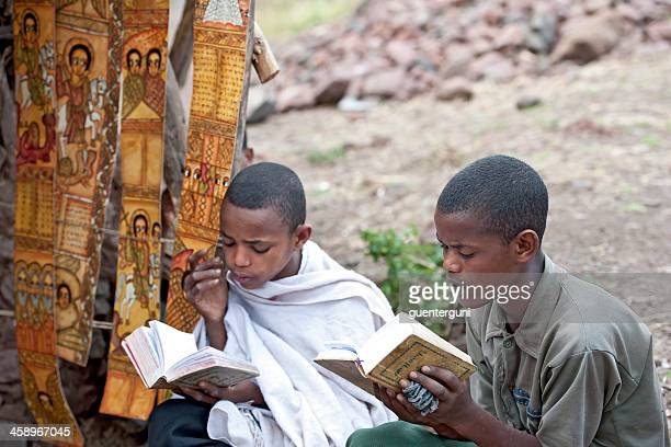 novices in an orthodox monastery is reading a holy book - orthodox church stock pictures, royalty-free photos & images